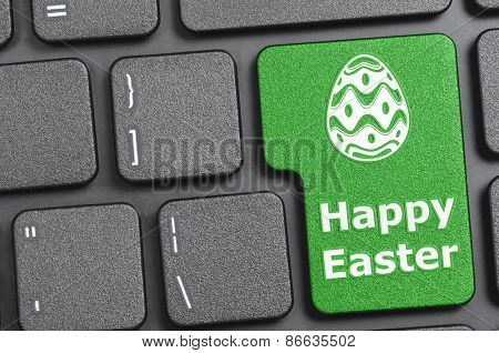 Green happy easter key on keyboard