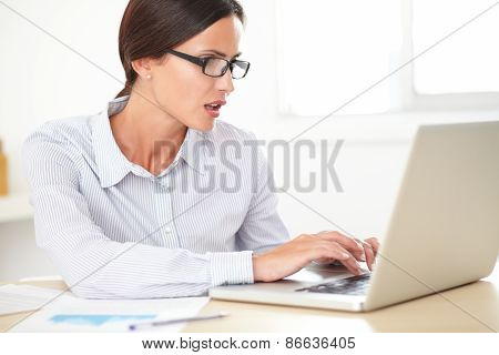 Confident Girl Secretary Using Her Computer