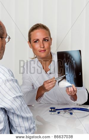patient and doctor talking on the advice of the doctor's office. orthopedist in the discussion of findings
