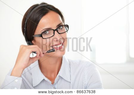 Charming Young Woman Speaking On Headphones