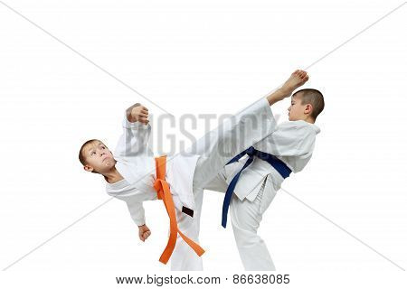 Strong children athletes are beating blows kicks