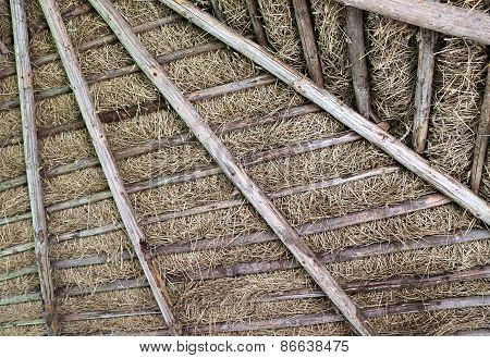 Background Is The Drying Of Hay On The Roof Of An Hut