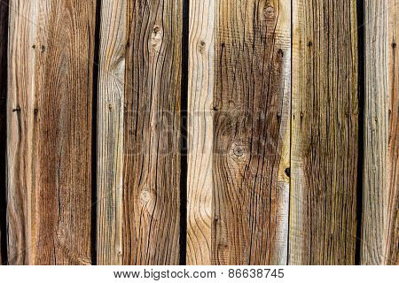 an old wooden wall of a barn. ideal for background