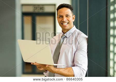 smart businessman with laptop in office
