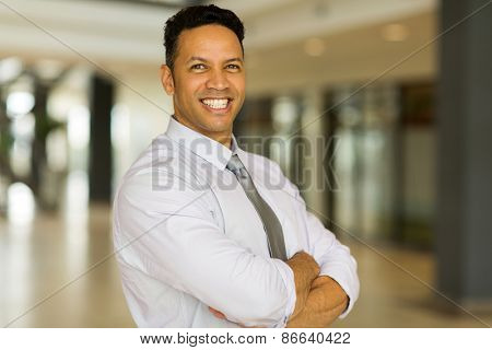handsome mid age office worker with arms crossed