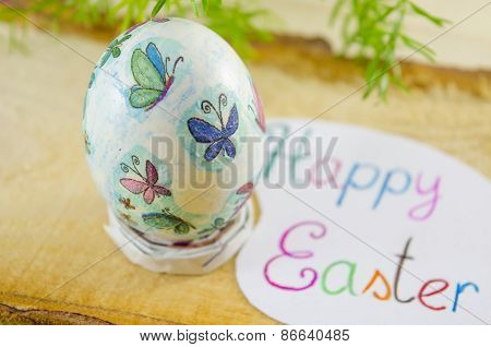Hand Painted Decoupage Easter Egg On A Wooden Surface