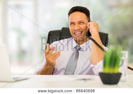 handsome office worker talking on telephone