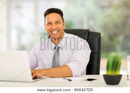 successful businessman using laptop computer in office