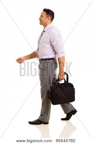 side view of businessman holding a bag walking isolated on white