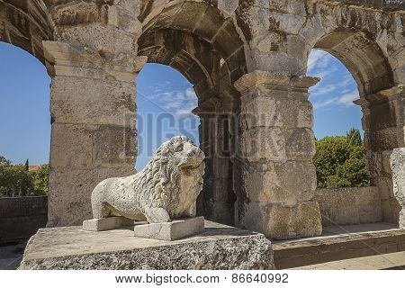 Wall Fragment Of Antique Roman Amphitheater With A Lion Monument In Pula