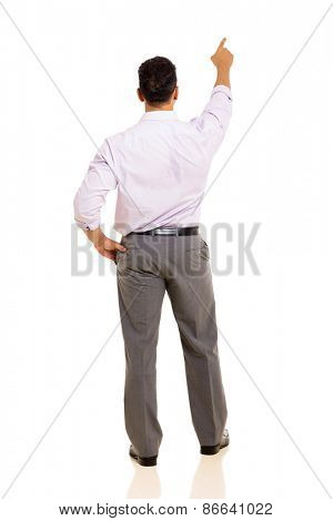 rear view of man pointing at empty copy space isolated on white