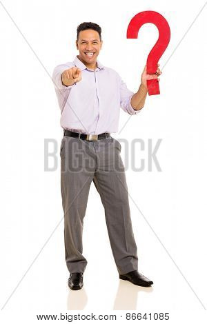 happy man holding question mark and pointing at the camera