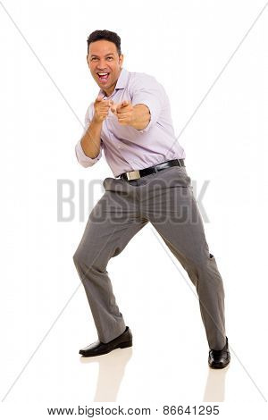 portrait of happy mid age businessman pointing at camera
