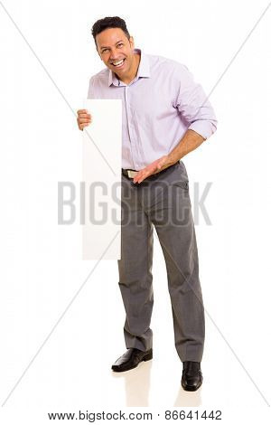 cheerful middle aged man presenting blank board on white background