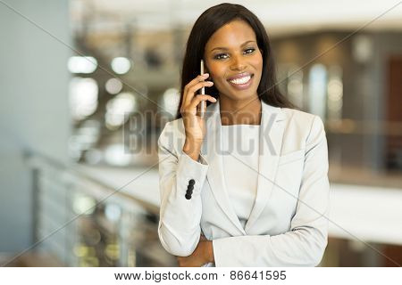 portrait of successful young black businesswoman talking on mobile phone