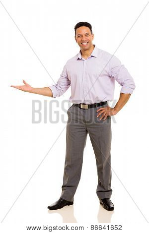 friendly middle aged businessman doing welcome gesture on white background