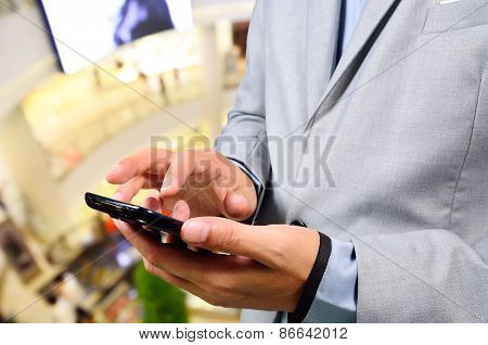 Business Man Use Mobile Phone In Shopping Mall