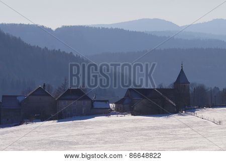 typical village during winter, Vosges, France