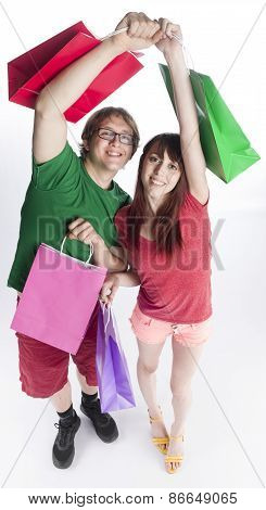 Happy Couple Holding and Raising Paper Bags