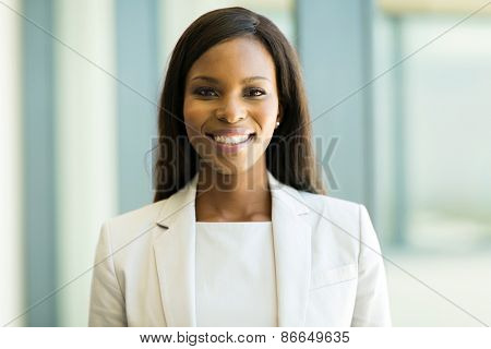 portrait of pretty young afro american business executive in office