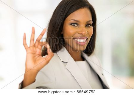 cheerful african american businesswoman giving ok hand sign