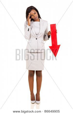 sad african businesswoman holding red arrow pointing down on white background