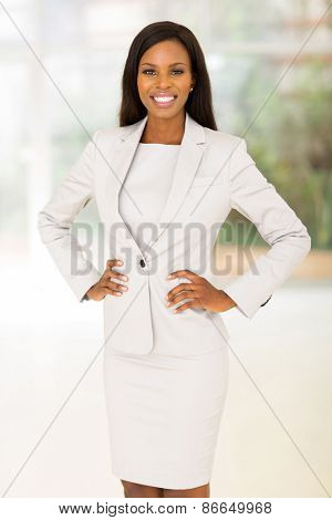 portrait of pretty young afro american business woman in office