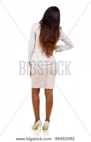 rear view of african woman having backache isolated on white background