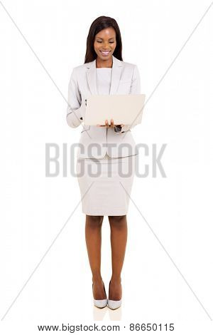 pretty african american businesswoman working on laptop isolated on white background