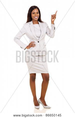 happy afro american businesswoman pointing up on white background