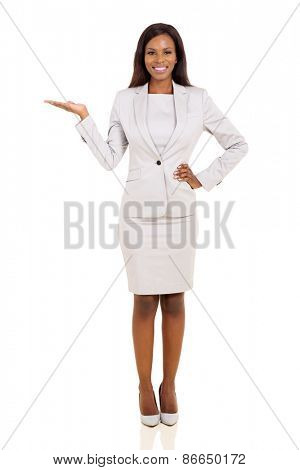 beautiful young african businesswoman presenting on white background