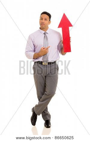 handsome mid age businessman pointing red arrow symbol isolated on white