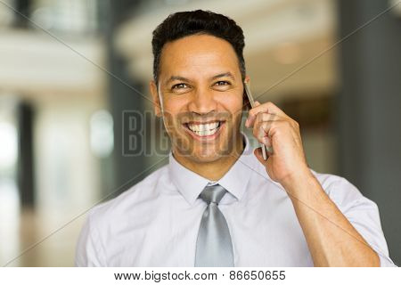 close up portrait of male corporate worker talking on cell phone