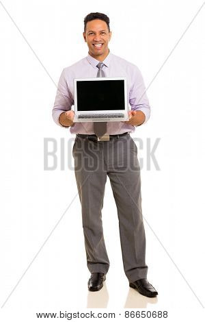 full length portrait of middle aged businessman presenting laptop