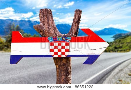 Croatia wooden sign with a road background