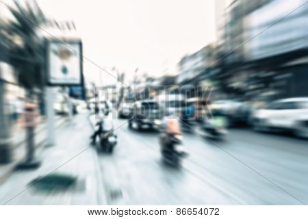 Blurred Vehicle And Motorcycle Moving On The Road In Town