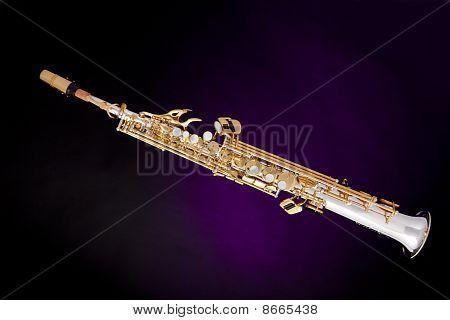 Soprano Saxophone Isolated On Purple