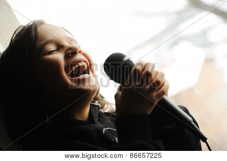 Kid singing song with microphone