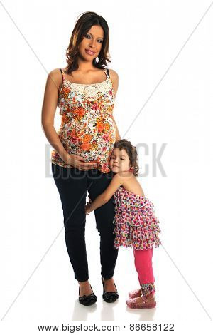 Hispanic pregnant woman with daughter standing isolated over white background