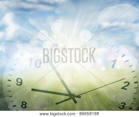 Clock face in spring field