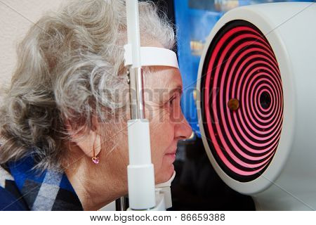 Optometry and ophthalmology.  senior woman patient under sight testing or eye examinations in clinic