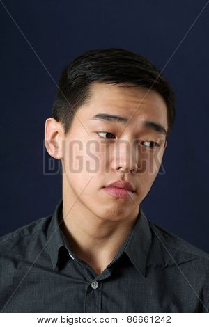 Romantic young Asian man looking sideways