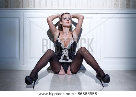 Sexy Woman Sitting On Floor