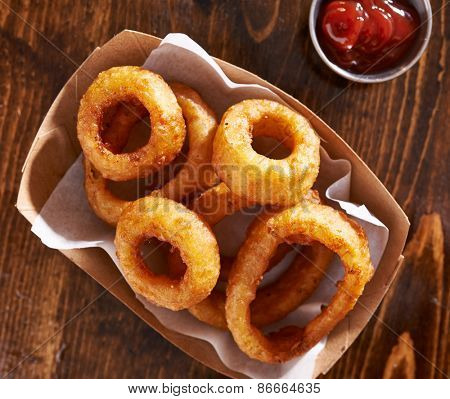 basket of onion rings shot from top overhead view