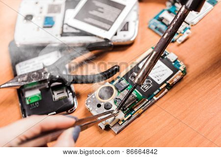Worker Repairing Fractured Phone
