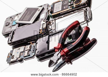 Broken Phones And Clippers Closeup