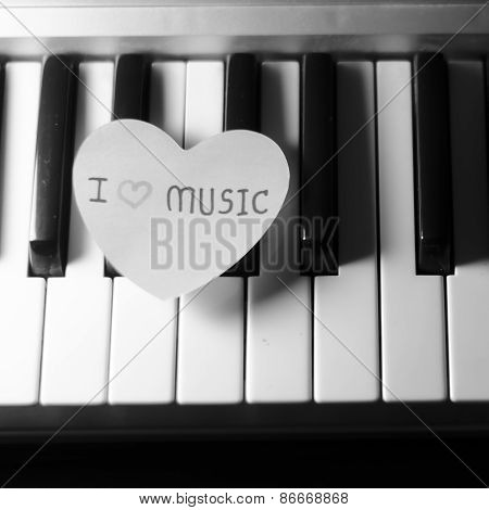 Paper Heart On Piano Keyboard Black And White