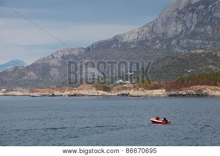 Coastal Norwegian Landscape With Mountains