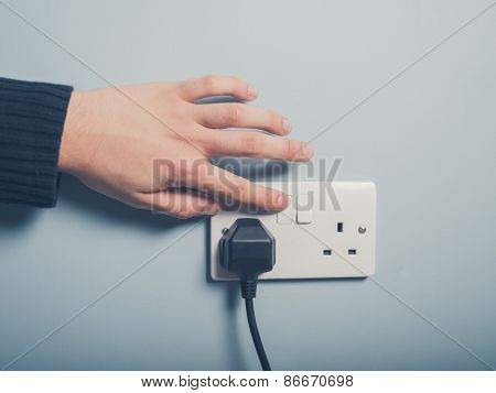 Male Hand Pushing Switch