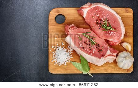 fresh meats on a black background